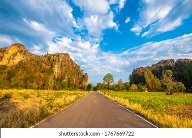 Asphalt raod to the land of old limestone mountain range, travel in Noen Maprang district, Phitsanulok, Central of Thailand
