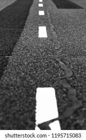 Asphalt with repaired areas