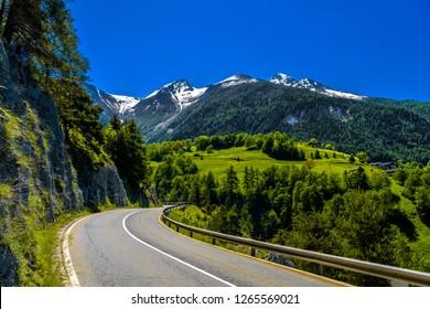 Asphalt road in Alps mountains in Moerel, Filet, Oestlich Raron, Wallis Valais Switzerland