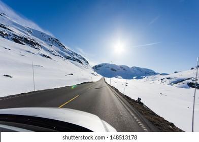 asphalt road among snow