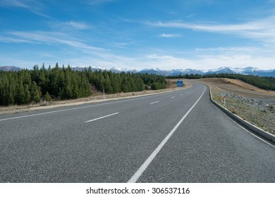 Asphalt Road to Aoraki Mount Cook with mountain range backdrop, South Island, New Zealand