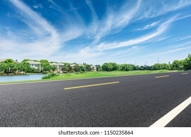 Asphalt road and apartment building scene in the suburbs of the city