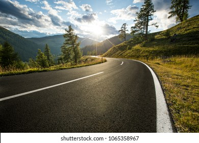 Asphalt road in Austria, Alps in a beautiful summer day, Nockalmstrasse.