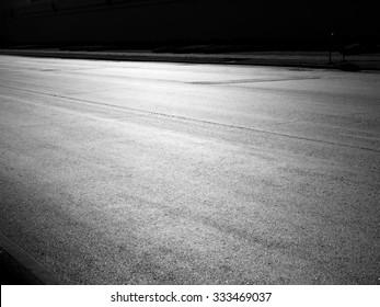 Asphalt road background with light