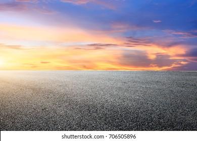 Asphalt road and beautiful sky landscape at sunset