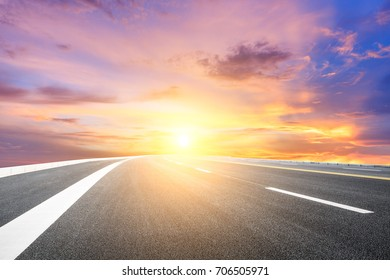 Asphalt road and beautiful sky landscape at sunset