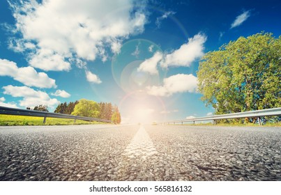 asphalt road in beautiful spring day at countryside with sunlight