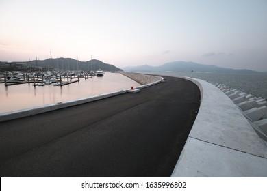 asphalt road beside the sea