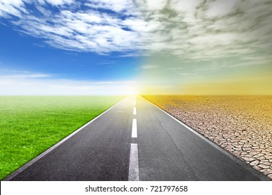 asphalt road between the changing environment. The concept of climate change.