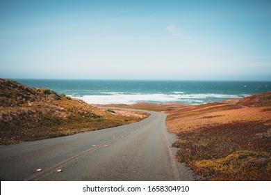 Asphalt road to the blue ocean blue sky paradise california beach point reyes national seashore