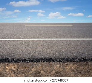 Asphalt road with blue sky background.