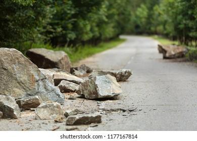 Asphalt road broken by a mountain avalanche