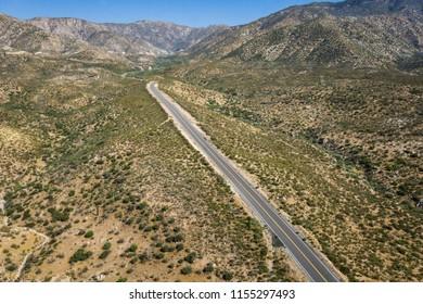 Asphalt road in California desert of Mojave near Los Angeles.