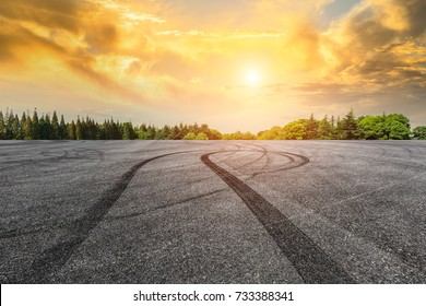 Asphalt road circuit and sky sunset with car tire brake