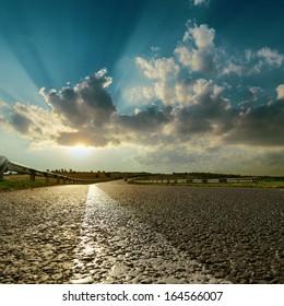 asphalt road close up to sunset
