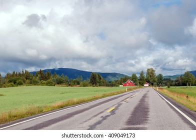 asphalt road to the country house in the mountains