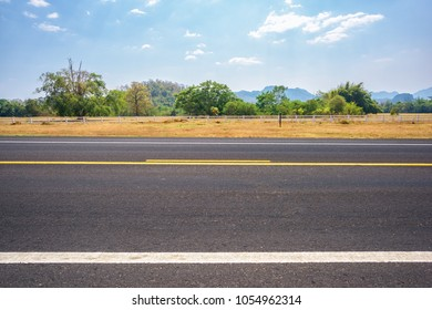 Asphalt road and countryside views