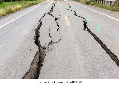 Asphalt road cracked and broken from earthquake.