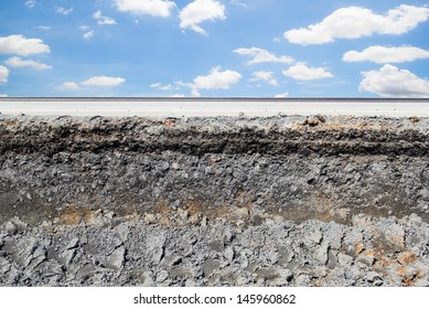 Asphalt road cross section in repair and reconstruction work. To show layer of surface and underground material i.e. asphalt concrete, bitumen, soil, sand, rock, stone, crust, ground and earth.