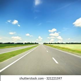 Asphalt road at day