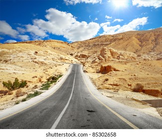 Asphalt road in a desert