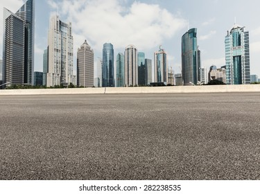Asphalt road in front of the modern city Shanghai china