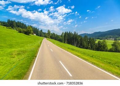 Asphalt road in Germany, Bavaria in a beautiful summer day