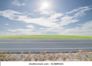 Asphalt Road with green grass ,blue sky background