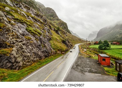 Asphalt road heading into the distance in Norwegian mountains. Rogaland, Norway, Europe, Scandinavia region. Norway is popular travel destination for tourist pursuits like hiking, backpacking etc.