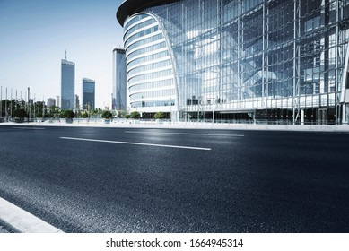 Asphalt road High way Empty curved road clouds and sky at sunset - Shutterstock ID 1664945314