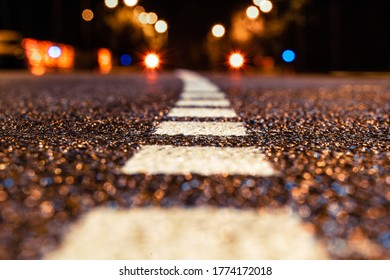asphalt road leading into the city at night. Selective focus. background - Shutterstock ID 1774172018