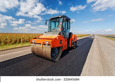 Asphalt road making construction site with heavy machines