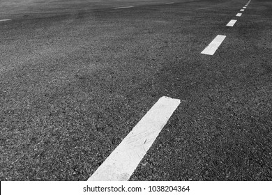 Asphalt road with marking lines white stripes texture Background.