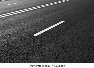 Asphalt road with marking lines white stripes