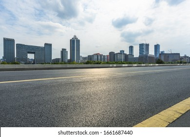 Asphalt road and modern city commercial buildings in Beijing, China