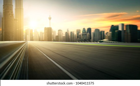 Asphalt road of Modern city with skyscrapers as background. Moti
