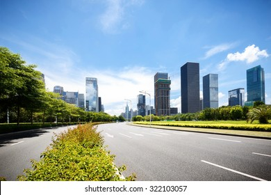 asphalt road of a modern city with skyscrapers as background