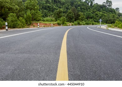 asphalt road and mountain forest area