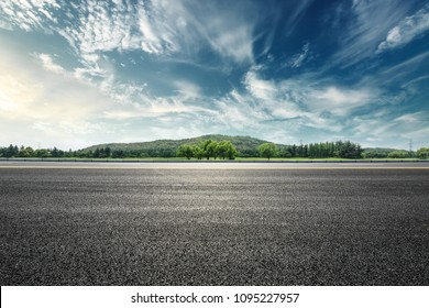 Asphalt road and mountain with sky clouds landscape at sunset