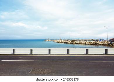 Asphalt road near the port and sea promenade