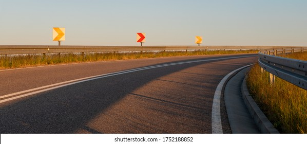 asphalt road on the bypass highway in the light of the setting sun