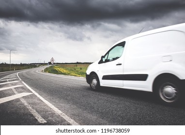 asphalt road on with a small truck. van moving