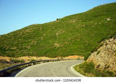 Asphalt road on the west coast of Crete island, Greece