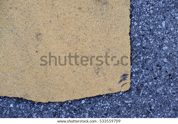 asphalt road painted yellow