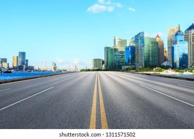 Asphalt road passes through Shanghai Lujiazui Financial District