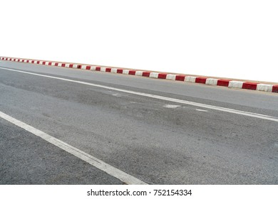 Asphalt road with red and white curb