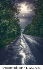 asphalt road. Shallow depth of field. Along the road. Sunset and lightning
