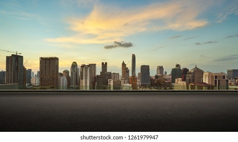 Asphalt road side with beautiful Bangkok city skyline. evening scene