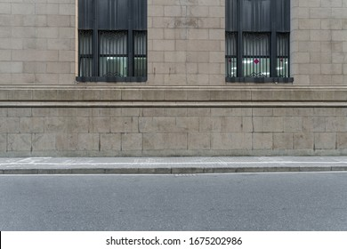 asphalt road and sidewalk with wall of european style architecture . - Shutterstock ID 1675202986