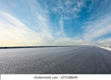 Asphalt road and sky cloud background